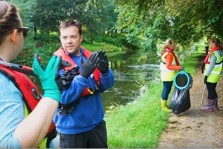 PPE volunteers in local canal cleanup
